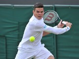 Canada's Milos Raonic returns against Australia's Matthew Ebden during their men's first round match on day two of the 2014 Wimbledon Championships at The All England Tennis Club in Wimbledon, southwest London, on June 24, 2014