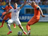 Netherlands' forward Arjen Robben vies with Chile's midfielder Charles Aranguiz during a Group B football match between Netherlands and Chile at the Corinthians Arena in Sao Paulo during the 2014 FIFA World Cup on June 23, 2014