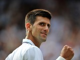Serbia's Novak Djokovic reacts after scoring a point against Kazakhstan's Andrey Golubev during their men's singles first round match on day one of the 2014 Wimbledon Championships at The All England Tennis Club in Wimbledon, southwest London, on June 23,