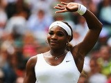 Serena Williams of the United celebrates after winning her Ladies' Singles second round match against Chanelle Scheepers on June 26, 2014