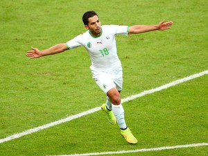 Abdelmoumene Djabou of Algeria celebrates scoring his team's third goal during the 2014 FIFA World Cup Brazil Group H match between South Korea and Algeria at Estadio Beira-Rio on June 22, 2014