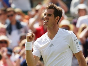 Andy Murray of Great Britain celebrates after winning his Gentlemen's Singles second round match against Blaz Rola of Slovenia on day three of the Wimbledon Lawn Tennis Championships at the All England Lawn Tennis and Croquet Club at Wimbledon on June 25,