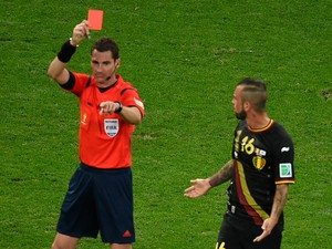Belgium's midfielder Steven Defour is shown a red card by Australian referee Benjamin Jon Williams during a Group H football match between South Korea and Belgium at the Corinthians Arena in Sao Paulo during the 2014 FIFA World Cup on June 26, 2014