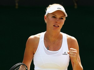 Caroline Wozniacki of Denmark celebrates after winning her Ladies' Singles third round match against Ana Konjuh of Croatia on day five of the Wimbledon Lawn Tennis Championships at the All England Lawn Tennis and Croquet Club on June 27, 2014