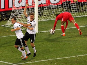 Thomas Muller of Germany celebrates scoring with team mate Mesut Ozil during the 2010 FIFA World Cup South Africa Round of Sixteen match between Germany and England at Free State Stadium on June 27, 2010