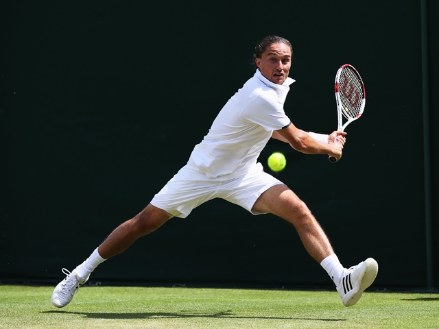 Alexandr Dolgopolov of Ukraine plays a backhand shot during his Gentlemen's Singles second round match against Benjamin Becker of Germany on day three of the Wimbledon Lawn Tennis Championships at the All England Lawn Tennis and Croquet Club at Wimbledon