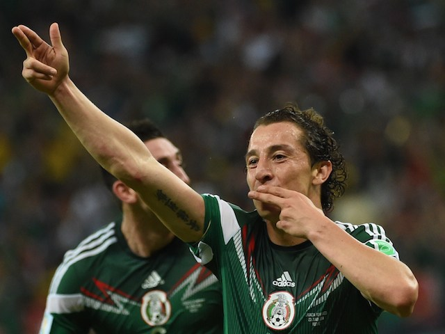 Mexico's defender Andres Guardado celebrates after scoring the 0-2 during a Group A football match against Croatia on June 23, 2014