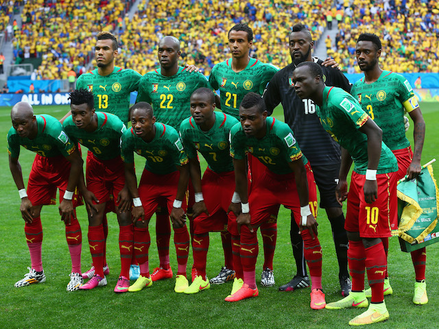 Cameroon pose for a team photo prior to the 2014 FIFA World Cup Brazil Group A match between Cameroon and Brazil at Estadio Nacional on June 23, 2014
