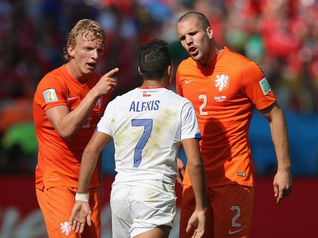 Holland's Daley Blind and Ron Vlaar argue with Chile's Alexis Sanchez on June 23, 2014.