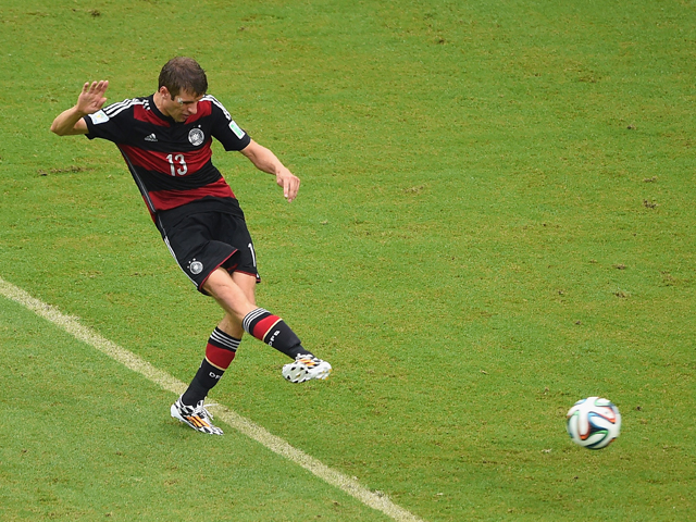 Thomas Mueller of Germany shoots and scores his team's first goal during the 2014 FIFA World Cup Brazil group G match between the United States and Germany at Arena Pernambuco on June 26, 2014