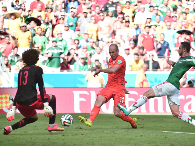 Netherlands' forward Arjen Robben vies for the ball with Mexico's defender Miguel Layun and Mexico's goalkeeper Guillermo Ochoa during a Round of 16 football match between Netherlands and Mexico at Castelao Stadium in Fortaleza during the 2014 FIFA World