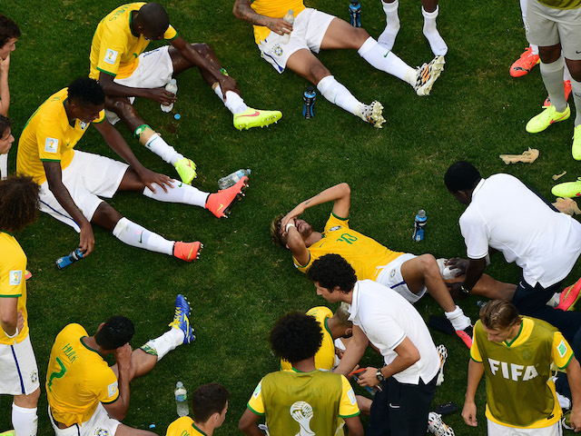 Brazil forward Neymar receives treatment prior to the start of extra time against Chile in the World Cup last-16 match in Belo Horizonte on June 28, 2014