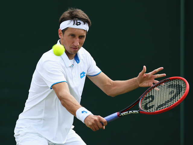 Sergiy Stakhovsky of Ukraine returns the ball during his Gentlemen's Singles second round match against Ernests Gulbis of Latvia on day three of the Wimbledon Lawn Tennis Championships at the All England Lawn Tennis and Croquet Club at Wimbledon on June 2