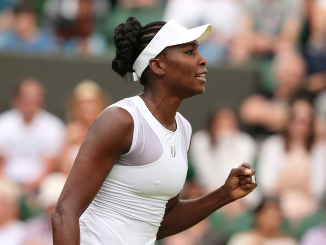 US player Venus Williams returns against Spain's Maria-Teresa Torro-Flor during their women's singles first round match on day one of the 2014 Wimbledon Championships at The All England Tennis Club in Wimbledon, southwest London, on June 23, 2014