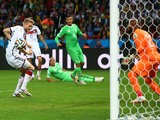 Andre Schuerrle of Germany scores his team's first goal past goalkeeper Rais M'Bolhi of Algeria in extra time during the 2014 FIFA World Cup on June 30, 2014