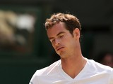 Britain's Andy Murray reacts to losing a point against Bulgaria's Grigor Dimitrov during their men's singles quarter-final match on day nine of the 2014 Wimbledon Championships at The All England Tennis Club in Wimbledon, southwest London, on July 2, 2014