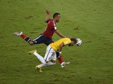Colombia's defender Juan Camilo Zuniga challenges Brazil's forward Neymar during the quarter-final football match between Brazil and Colombia at the Castelao Stadium in Fortaleza during the 2014 FIFA World Cup on July 4, 2014