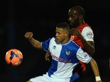 Alefe Santos of Bristol Rovers battles with Jamal Fyfield of York City during the FA Cup First Round match between Bristol Rovers and York City at Memorial Stadium on November 8, 2013