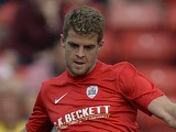 Martin Cranie of Barnsley plays the ball during a pre-season friendly against Club Brugge at Oakwell Stadium on July 12, 2013