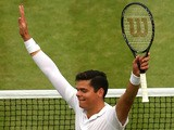 Milos Raonic of Canada celebrates after winning his Gentlemen's Singles quarter-final match against Nick Kyrgios on July 2, 2014