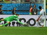 Netherlands' goalkeeper Tim Krul saves Costa Rica's forward and captain Bryan Ruiz shot during the second period of extra time in the quarter-final football match between the Netherlands and Costa Rica at the Fonte Nova Arena in Salvador during the 2014 F