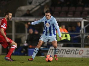 Blair Adams of Coventry City in action during the FA Cup with Budweiser Second Round Replay between Coventry City and Hartlepool United at Sixfields Stadium on December 17, 2013