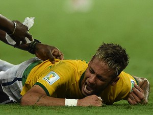 Brazil's forward Neymar lies on the pitch after being injured during the quarter-final football match between Brazil and Colombia at the Castelao Stadium in Fortaleza during the 2014 FIFA World Cup on July 4, 2014