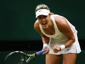 Eugenie Bouchard of Canada celebrates after winning her Ladies' Singles fourth round match against Alize Cornet of France on day seven of the Wimbledon Lawn Tennis Championships at the All England Lawn Tennis and Croquet Club on June 30, 2014