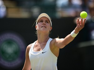 Canada's Eugenie Bouchard serves to Germany's Angelique Kerber during their women's singles quarter-final match on day nine of the 2014 Wimbledon Championships at The All England Tennis Club in Wimbledon, southwest London, on July 2, 2014