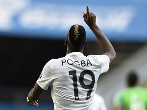 France's midfielder Paul Pogba celebrates after scoring the first goal during a Round of 16 football match between France and Nigeria at Mane Garrincha National Stadium in Brasilia during the 2014 FIFA World Cup on June 30, 2014