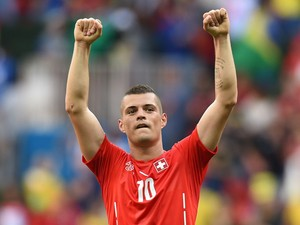 Switzerland's midfielder Granit Xhaka celebrates their victory at the end of a Group E football match between Switzerland and Ecuador at the Mane Garrincha National Stadium in Brasilia during the 2014 FIFA World Cup on June 15, 2014