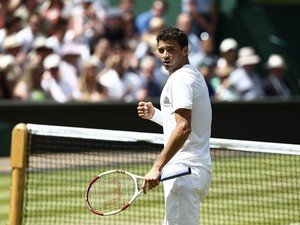 Bulgaria's Grigor Dimitrov reacts to winning the first set against Britain's Andy Murray during their men's singles quarter-final match on day nine of the 2014 Wimbledon Championships at The All England Tennis Club in Wimbledon, southwest London, on July