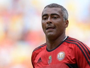 Brazilian former football star Romario looks on during a charity football match organized by former Brazilian national team player Zico, at Maracana stadium on December 28, 2013
