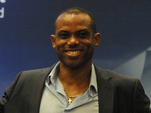Former Nigerian international Sunday Oliseh poses with UEFA Trophy displayed for public viewing at Eko Hotel on March 15, 2014