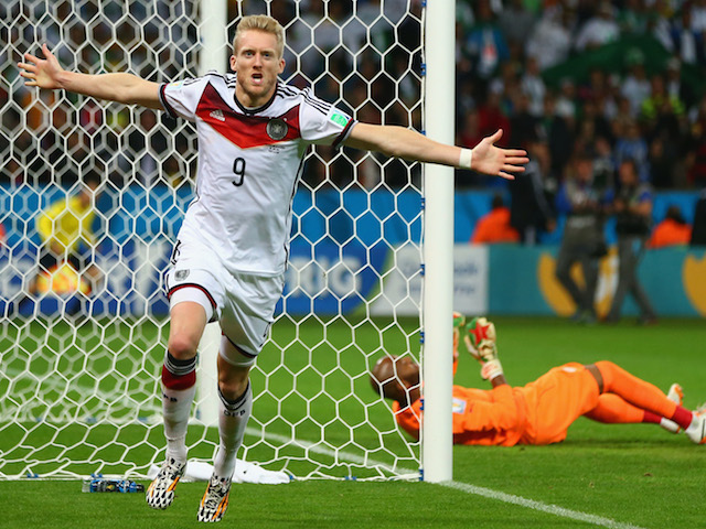 Andre Schuerrle of Germany celebrates scoring his team's first goal past goalkeeper Rais M'Bolhi of Algeria during the 2014 FIFA World Cup on June 30, 2014