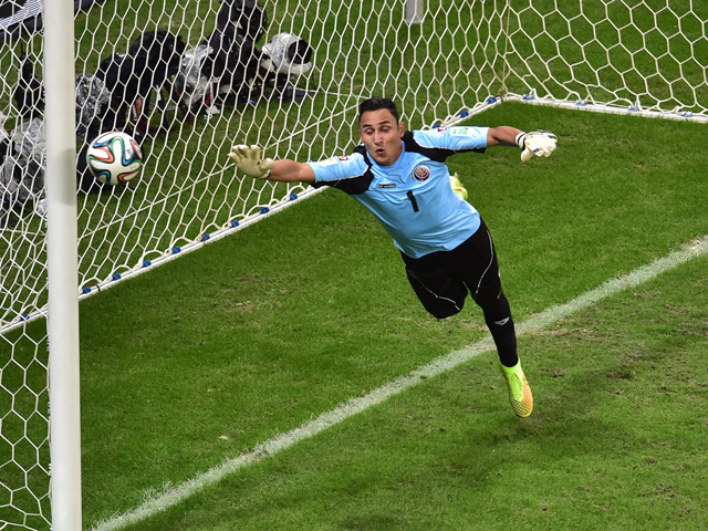 Costa Rica's goalkeeper Keylor Navas jumps to make a save during a quarter-final football match between Netherlands and Costa Rica at the Fonte Nova Arena in Salvador during the 2014 FIFA World Cup on July 5, 2014