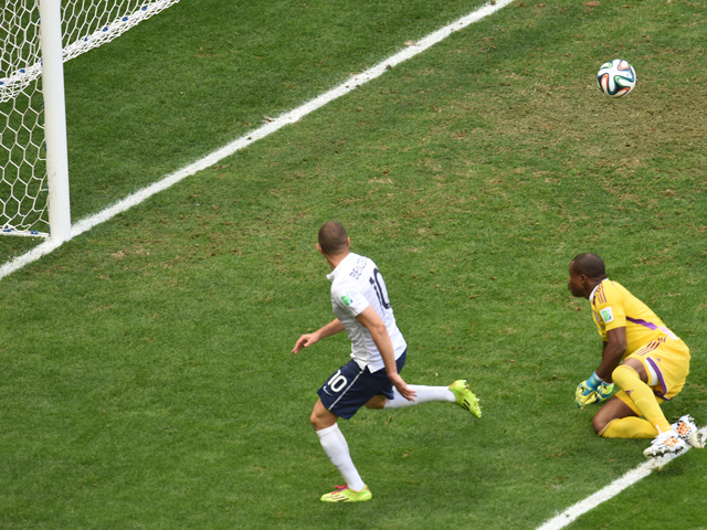 France's forward Karim Benzema makes a failed attempt at goal next to Nigeria's goalkeeper Vincent Enyeama during a Round of 16 football match between France and Nigeria at Mane Garrincha National Stadium in Brasilia during the 2014 FIFA World Cup on June
