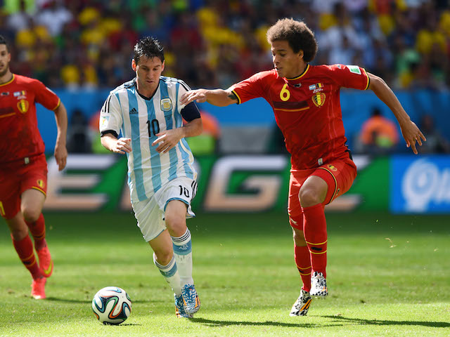 Lionel Messi of Argentina is challenged by Axel Witsel of Belgium (R) during the 2014 FIFA World Cup Brazil Quarter Final match on July 5, 2014