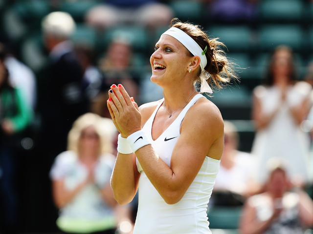 Lucie Safarova of Czech Republic celebrates winning her Ladies' Singles quarter-final match against Ekaterina Makarova of Russia on day eight of the Wimbledon Lawn Tennis Championships at the All England Lawn Tennis and Croquet Club on July 1, 2014