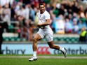 Dan Norton of England breaks away to score a try during the Marriot London Sevens match between England and Argentina at Twickenham Stadium on May 10, 2014 in London, England