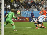 Argentina's forward Gonzalo Higuain takes a shot on goal during the semi-final football match between Netherlands and Argentina of the FIFA World Cup at The Corinthians Arena in Sao Paulo on July 9, 2014