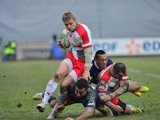 Biarritz's wing Iain Balshaw runs with the ball during the European Rugby Union H Cup match Zebre Parme vs Biarritz Olympique at the XXV Aprile stadium in Parma on January 12, 2013