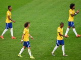 Luiz Gustavo, David Luiz, Fernandinho and Dante of Brazil look dejected after a goal during the 2014 FIFA World Cup Brazil Semi Final match on July 8, 2014