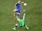 Germany's goalkeeper Manuel Neuer (FRONT) prepares to make a save from Argentina's forward Rodrigo Palacio during the final football match o