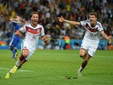 Mario Goetze of Germany (L) celebrates scoring his team's first goal with Thomas Mueller during the 2014 FIFA World Cup Brazil Final match on July 13, 2014