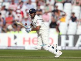 Mahendra Singh Dhoni of India takes a run during day one of the 1st Investec Test between England and India at Trent Bridge on July 9, 2014