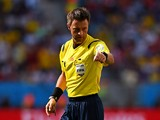Referee Nicola Rizzoli gestures during the 2014 FIFA World Cup Brazil Quarter Final match between Argentina and Belgium at Estadio Nacional on July 5, 2014