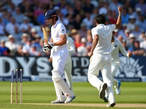 England captain Alastair Cook leaves the crease after being bowled by Mohammed Shami for 5 runs during day two of the 1st Investec Test Match between England and India at Trent Bridge on July 10, 2014
