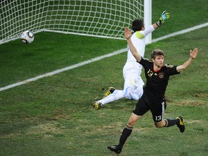 Germany's midfielder Thomas Muller scores past Uruguay's goalkeeper Fernando Muslera during the 2010 World Cup third place football match between Uruguay and Germany on July 10, 2010