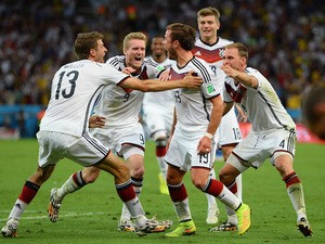 Mario Goetze of Germany (C) celebrates scoring his team's first goal in extra time with teammates Thomas Mueller, Andre Schuerrle and Toni Kroos on July 13, 2014